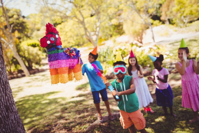 group of kids playing with a piñata | BlairCandy.com